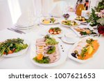 Small photo of Vegetable and cold cuts platter with souse on the table