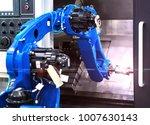 close up robot hands in milling ... | Shutterstock . vector #1007630143
