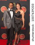 Small photo of Larenz Tate and guest arrives on the Red Carpet for the 26th annual Bounce Trumpet Awards on January 20th 2018 at the Cobb Energy Performing Arts Centre in Atlanta Georgia-USA