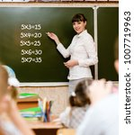 teacher teaches students the... | Shutterstock . vector #1007719963