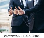 businessmans show the symbol of ... | Shutterstock . vector #1007738803