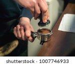 barista makes coffee  close up  ...   Shutterstock . vector #1007746933