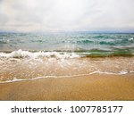 Small Wave On A Sunny Day By...