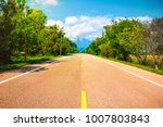shot of the road to mountain... | Shutterstock . vector #1007803843