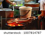 barbecued suckling pig fire... | Shutterstock . vector #1007814787
