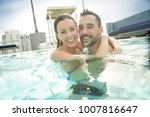 cheerful couple enjoying bath... | Shutterstock . vector #1007816647