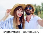 traveling couple in love making ... | Shutterstock . vector #1007862877