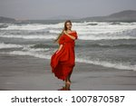 fashion woman in red dress | Shutterstock . vector #1007870587
