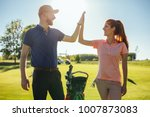young couple doing a high five... | Shutterstock . vector #1007873083