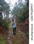 woman walks through the forest   Shutterstock . vector #1007928997