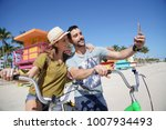 young couple riding bikes in...   Shutterstock . vector #1007934493