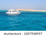 white yacht on the blue water... | Shutterstock . vector #1007938957
