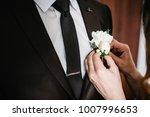bride's hands puts the groom on ... | Shutterstock . vector #1007996653