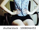 young woman in a blue and...   Shutterstock . vector #1008046453