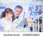 scientists researching in... | Shutterstock . vector #1008053803