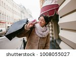 a girl holds many packages on...   Shutterstock . vector #1008055027