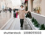 girl with packages goes down...   Shutterstock . vector #1008055033