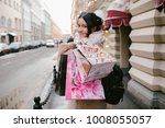 girl with packages goes down...   Shutterstock . vector #1008055057