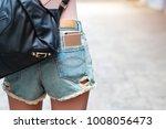 young woman has smart phone in...   Shutterstock . vector #1008056473