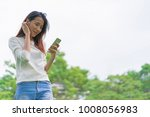 happy young woman holding...   Shutterstock . vector #1008056983