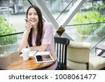young asian business owner...   Shutterstock . vector #1008061477