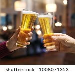 beer glasses raised in a toast. ... | Shutterstock . vector #1008071353