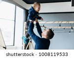 father plays with little son in ... | Shutterstock . vector #1008119533