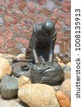 Small photo of PUERTO VALLARTA MEXICO MAY 07 2016: Washer Woman bronze statue by Jim Demetro, placed in 2008 near the Cuale River bridge and in front of the Molino de Agua condos along the malecon boardwalk