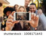 woman taking self portrait with ... | Shutterstock . vector #1008171643