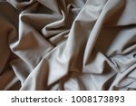 Small photo of Draped simple beige viscose and polyester fabric
