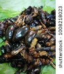 Small photo of fried bugs on banana left,insects as smack