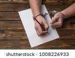men's hands with handcuffs fill ... | Shutterstock . vector #1008226933