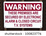 Informative warning sign on a metal fence - stock photo