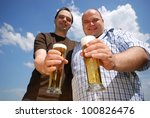 two happy man with fresh beer - stock photo