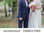 groom with the bride in the... | Shutterstock . vector #1008317083