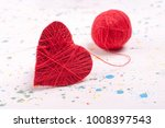 Close Up Red Knitted Heart And...