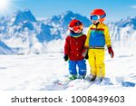 child skiing in the mountains.... | Shutterstock . vector #1008439603