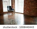 chair stands near a window on... | Shutterstock . vector #1008440443