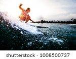 surfer rides the ocean wave... | Shutterstock . vector #1008500737
