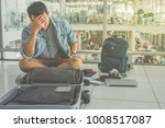 young traveler sitting at the... | Shutterstock . vector #1008517087