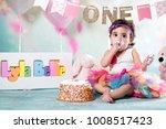 baby girl cake smash | Shutterstock . vector #1008517423
