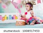 baby girl cake smash | Shutterstock . vector #1008517453