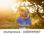 the father holds the daughter... | Shutterstock . vector #1008549487