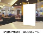 mock up menu frame standing on... | Shutterstock . vector #1008569743