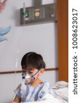 Small photo of Asian boy suffering from respiratory disease