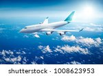 airplane flying above clouds  ... | Shutterstock . vector #1008623953