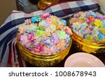 Small photo of Colorful almsgiving with ribbon-flowers in Thailand culture