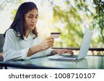 young woman with credit card... | Shutterstock . vector #1008710107