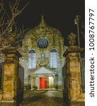 Small photo of Edinburgh Canongate Kirk by night Entrance, vertical photography, 17th-century Presbyterian church and burial place of eminent Scots, with a busy concert programme