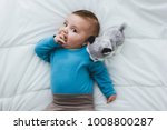 adorable baby sucking his hand | Shutterstock . vector #1008800287